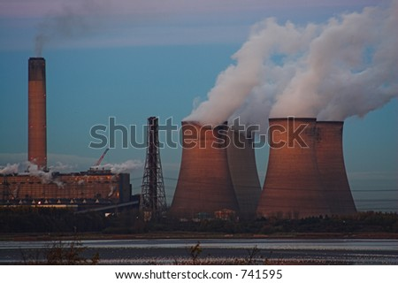 A coal powered power station at dusk - stock photo