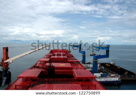 a coal tanker was doing the charging of coal that is ready to  be transported - stock photo