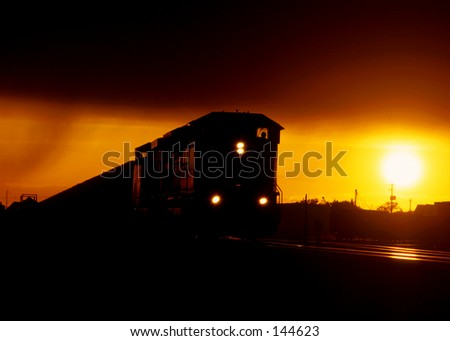 A coal train at sunset. - stock photo