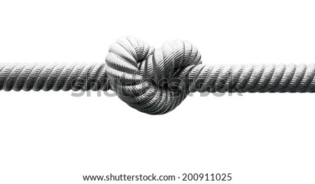 A coarse metal cable with a knot tied in the middle on an isolated background - stock photo