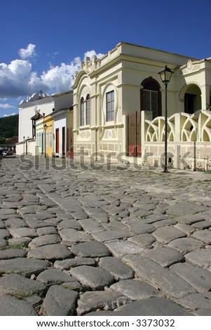 A cobblestone street in the Unesco world heritage site of Goias Velho. - stock photo
