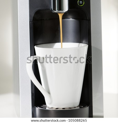 A coffe machine is brewing some coffee. - stock photo