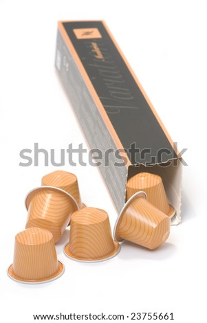 a coffee box with some capsules - stock photo