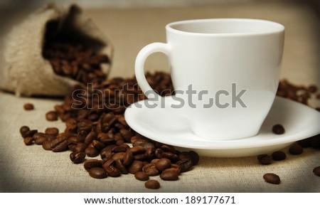 a coffee mug and coffee beans  - stock photo
