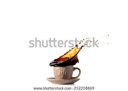 A coffee splash into a light brown cup - stock photo
