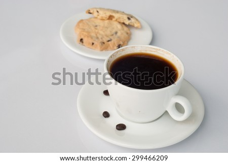 a coffee with cookies