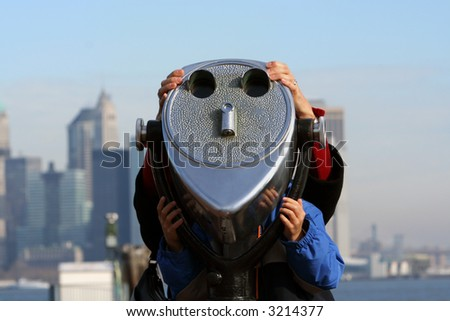 A coin operated binocular for viewing a landscape. - stock photo