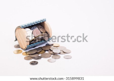 A coins money from small box with white background - stock photo
