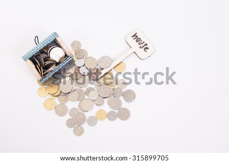 "A coins money from small box with white background and write signage ""house""  - stock photo"