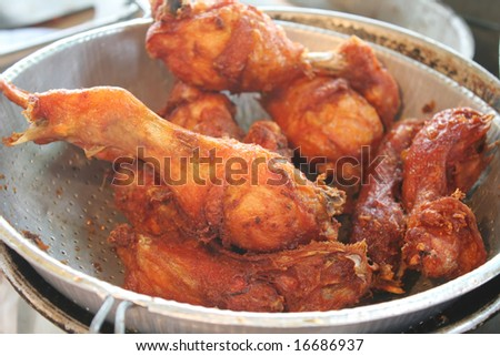 a colander full of fried chicken parts - stock photo