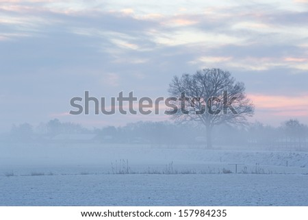 A cold but beautiful sunrise in winter - stock photo