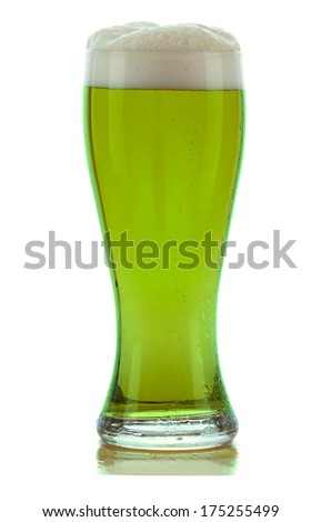 A cold frothy glass of green beer for St. Patricks Day isolated on white with a slight reflection. - stock photo