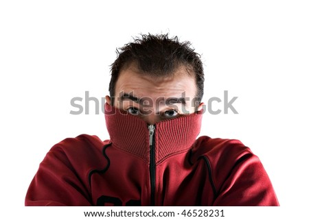A cold man shivering and burying his face into his sweater. A great concept for HVAC. - stock photo