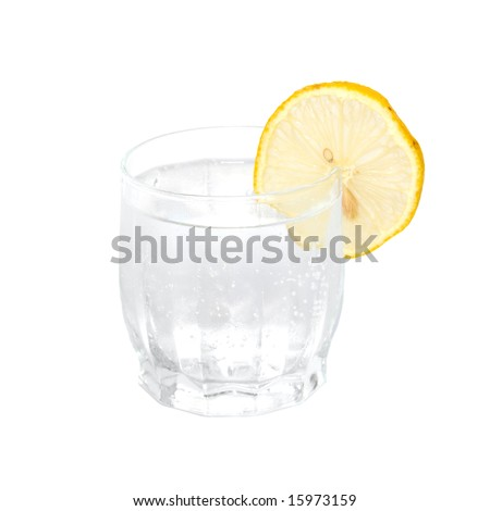 A cold water glass with lemon isolated on white.