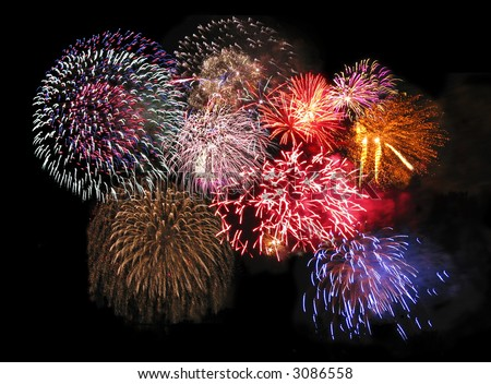 A collage of exploding fireworks. - stock photo