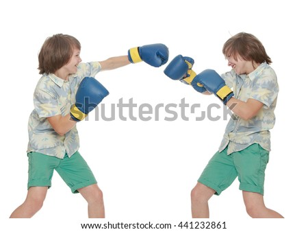 A collage of two photos where there is one person. Two identical young men in gloves-Boxing among themselves. Close-up-Isolated on white background - stock photo