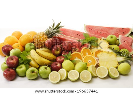 A collection of an assortment of tropical fruits on an isolated white background - stock photo