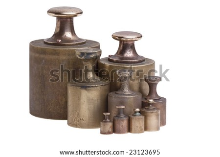 A collection of antique brass calibration weights isolated on white. - stock photo
