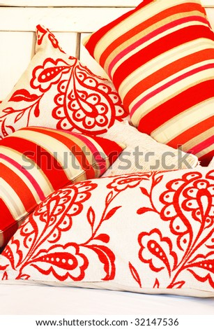 a Collection of bright colored pillows - stock photo
