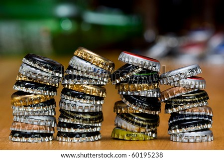 A collection of caps on a bar table - stock photo