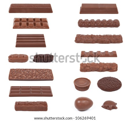 A collection of 17 chocolate candies isolated on white. - stock photo