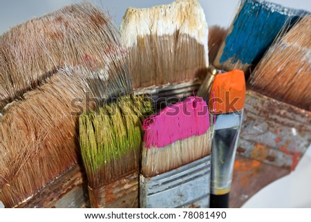 A collection of colorful paint brushes. - stock photo