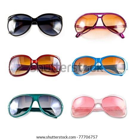 A collection of colorful sunglasses isolated on white background - stock photo