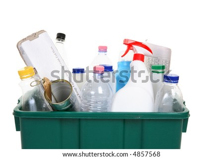 A collection of empty bottles, cans, paper and other containers in a recycling bin - stock photo