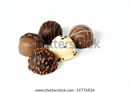 A collection of  fine dark, milk, and white chocolates - stock photo