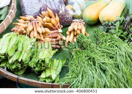 A collection of fresh and colorful vegetables being sold on a stall at a grocery store in Thailand - stock photo