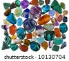 A collection of grinded precious stones used for collection, jewels and alternative healing practices (crystal healing) - stock photo
