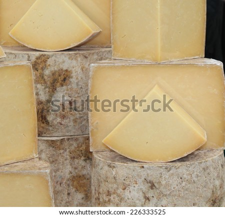 A Collection of Hard Round Cheeses on Display. - stock photo