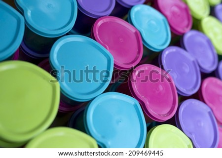 A collection of heart-shaped food containers of various colors - stock photo