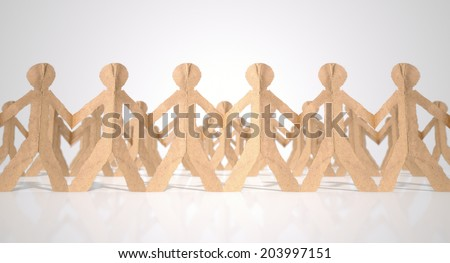 A collection of long rows of brown cardboard cutout men on an isolated white studio background - stock photo