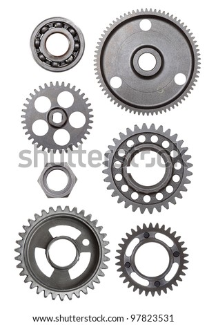 A collection of metal gears and objects isolated on a white background - stock photo