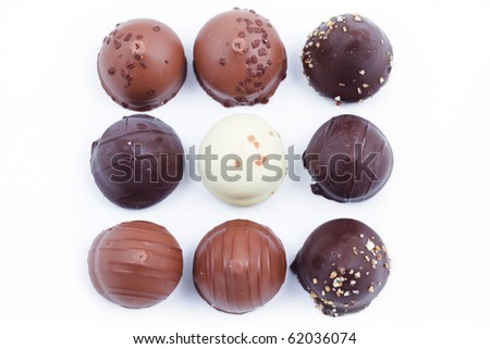 A collection of mixed chocolates and truffles - stock photo