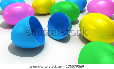 A collection of pastel colored plastic Easter eggs over a bright white background - stock photo