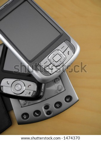 A collection of PDAs ranging from old to the newest in technology. - stock photo
