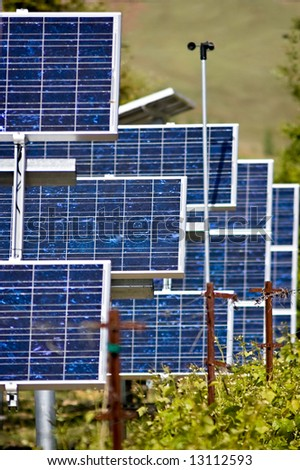 A collection of photo voltaic panels used to power a vineyard's equipment - stock photo