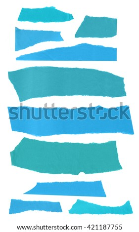 A collection of pieces of teal blue torn paper, isolated on white - stock photo