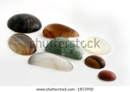 A collection of polished gemstones / minerals, isolated on white