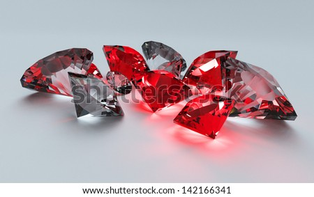A collection of rubies and diamonds scattering light on a plane white surface - stock photo