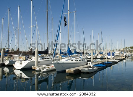 a collection of sailboats and yachts in a harbor - stock photo