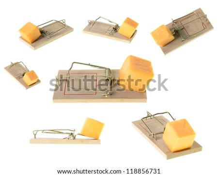 A collection of set mousetraps at different angles, isolated on a white background. - stock photo