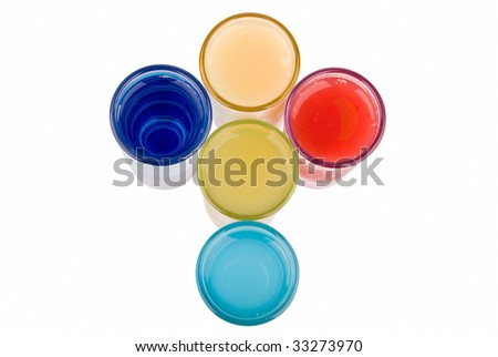 A collection of shot's in different colors on white background - stock photo