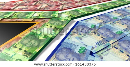 A collection of south african rand noted laid on top of and matching the colors of the south african national flag - stock photo