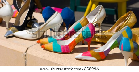 A collection of stylish and colorful high heels looking like the beginning of a fetish. - stock photo