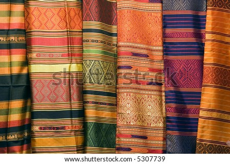 A collection of Thai silk cloths at the weekend market. - stock photo