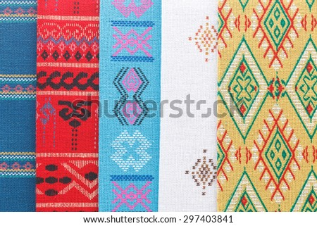 A collection of Thai silk. Colourful pattern of Thai silk . Thai style fabric background.