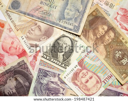 A collection of various currencies from countries spanning the globe - stock photo